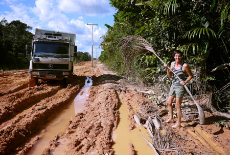 Using palm leaves to drive mud road